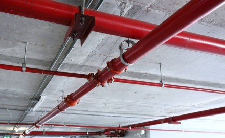 Welded gas and water tubes in an internal car parking